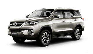 Camioneta fortuner toyota gris con vista lateral